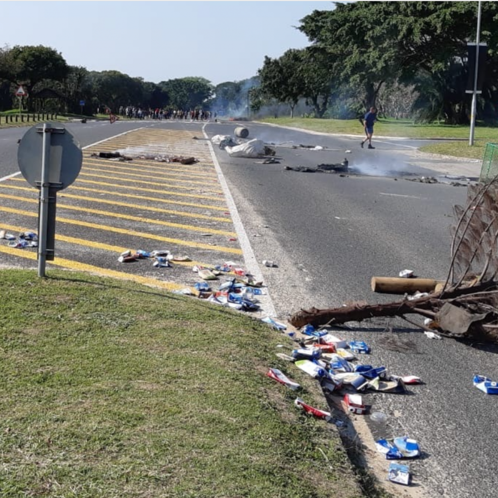 Trees, rubbish and debris scattered across a main road in South Africa